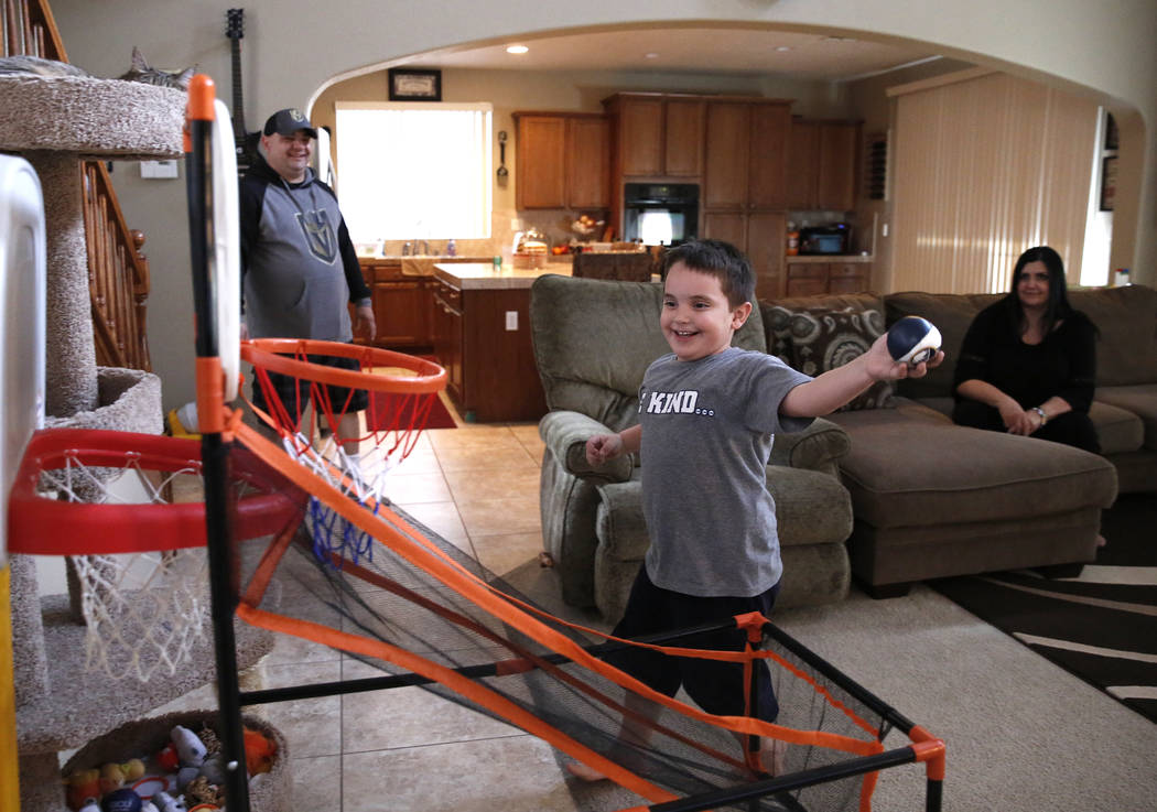 Jason Sebron, 5, plays as his mother Rhonda and his father Rick Nostro look on at their Henderson home on Wednesday, April 11, 2018. Bizuayehu Tesfaye/Las Vegas Review-Journal @bizutesfaye