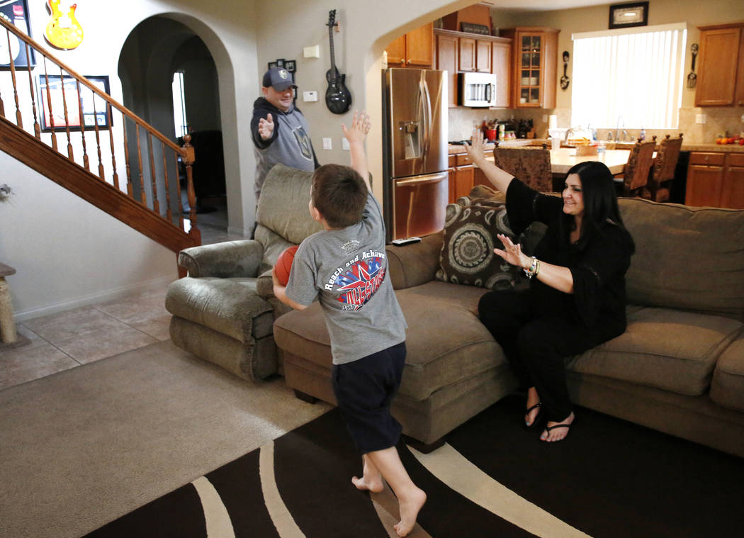 Jason Sebron, 5, high fives to his mother Rhonda Sebron and his father Rick Nostro at their Henderson home on Wednesday, April 11, 2018. Bizuayehu Tesfaye/Las Vegas Review-Journal @bizutesfaye
