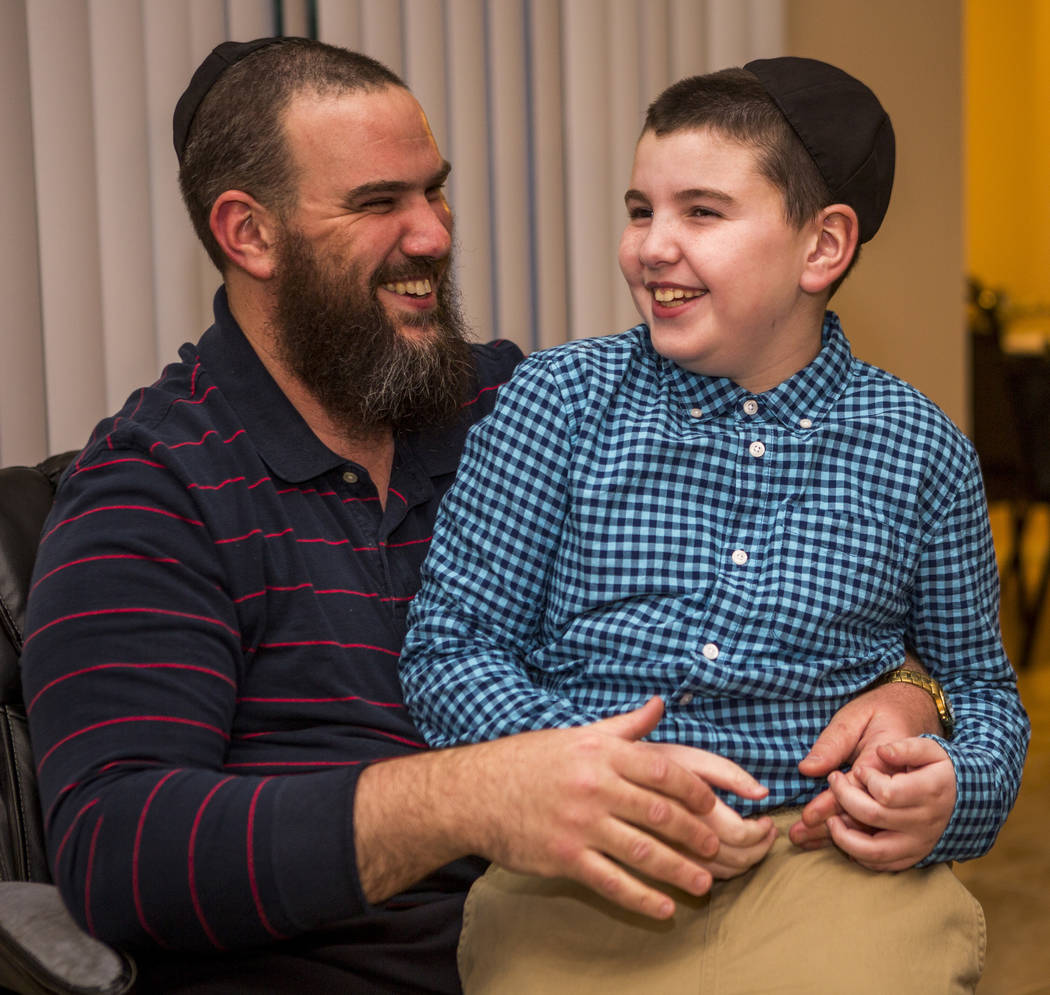 Guido Smerkin shares a moment with his son Yosef, 9, who has autism, at their Summerlin home on Thursday, April 12, 2018. Patrick Connolly Las Vegas Review-Journal @PConnPie