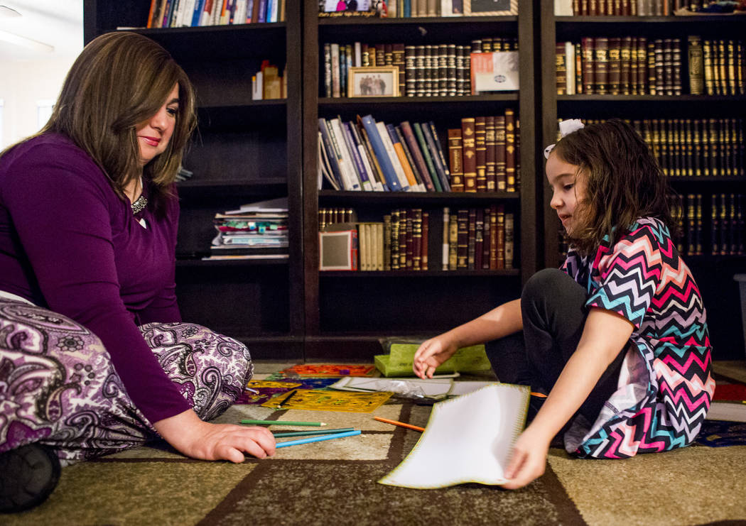 Luna Smerkin helps her daughter, Deborah, 6, who has autism, with a drawing project at their Summerlin home on Thursday, April 12, 2018. Patrick Connolly Las Vegas Review-Journal @PConnPie