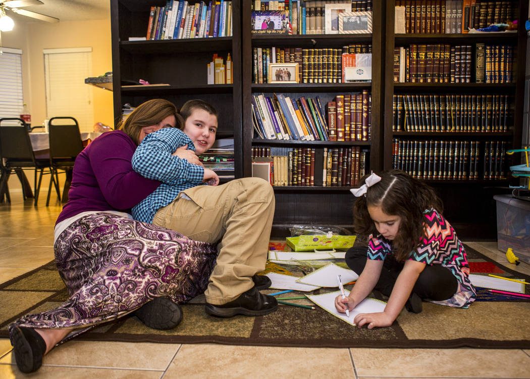 Luna Smerkin shares a moment with her son Yosef, 9, while Deborah, 6, draws at their Summerlin home on Thursday, April 12, 2018. Both Yosef and Deborah have autism. Patrick Connolly Las Vegas Rev ...
