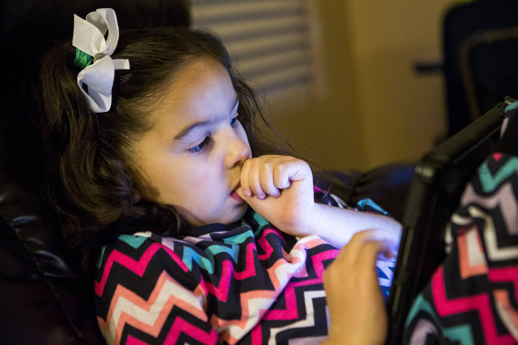 Deborah Smerkin, 6, who has autism, watches a video on a tablet at her family's Summerlin home on Thursday, April 12, 2018. Patrick Connolly Las Vegas Review-Journal @PConnPie