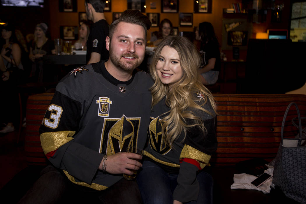Golden Knights fans Chaisson and Devan Prescott, who were both born in Vegas and met in high school, prior to the start of the team's first playoff game at Born and Raised in southwest Las Vegas o ...