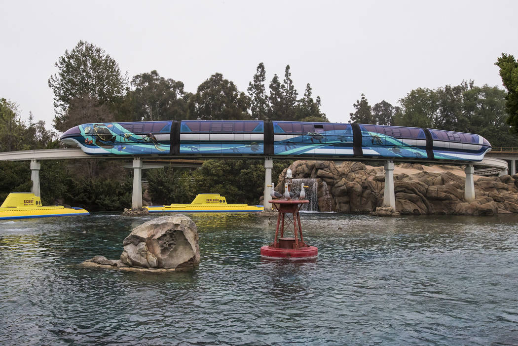 "The Disneyland Monorail is zipping through the resort with a new Pixar-themed look to celebrate Pixar Fest! The blue train, inspired by Disney•Pixar's ""Finding Nemo,"" features Crush and Sq ..."