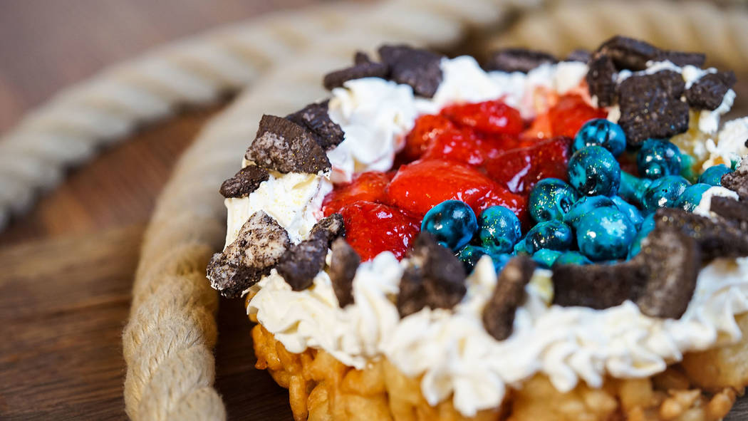 Favorite Pixar pals and stories are inspiring delicious treats, such as berry funnel cake at Golden Horseshoe, Disneyland park. (Disneyland Resort)