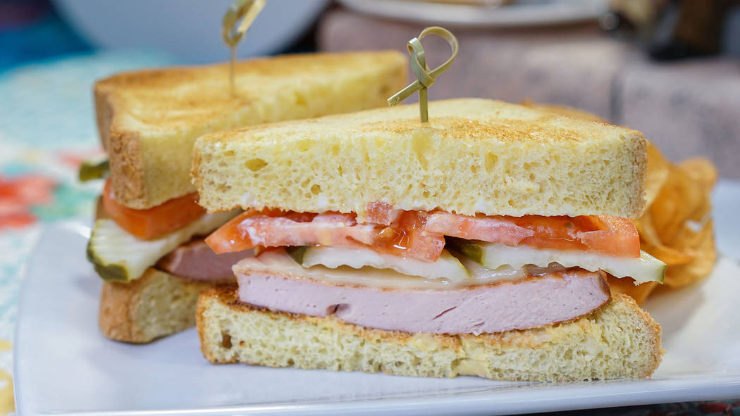 Favorite Pixar pals and stories are inspiring delicious eats, such as this fried bologna sandwich at Carnation Cafe in Disneyland park. (Disneyland Resort)
