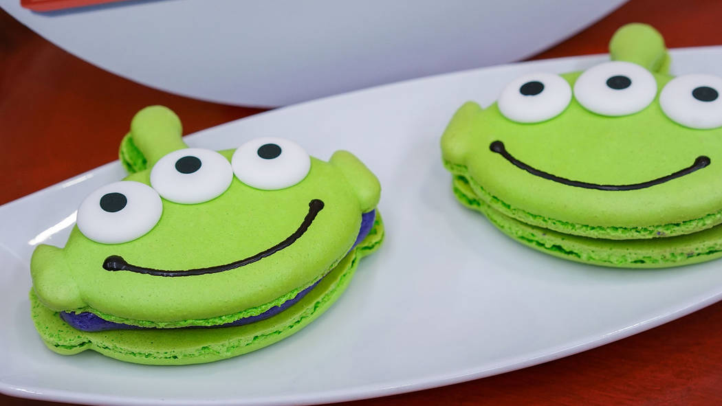 Favorite Pixar pals and stories are inspiring delicious treats, such as this alien macaroon in Tomorrowland at Disneyland park. (Disneyland Resort)