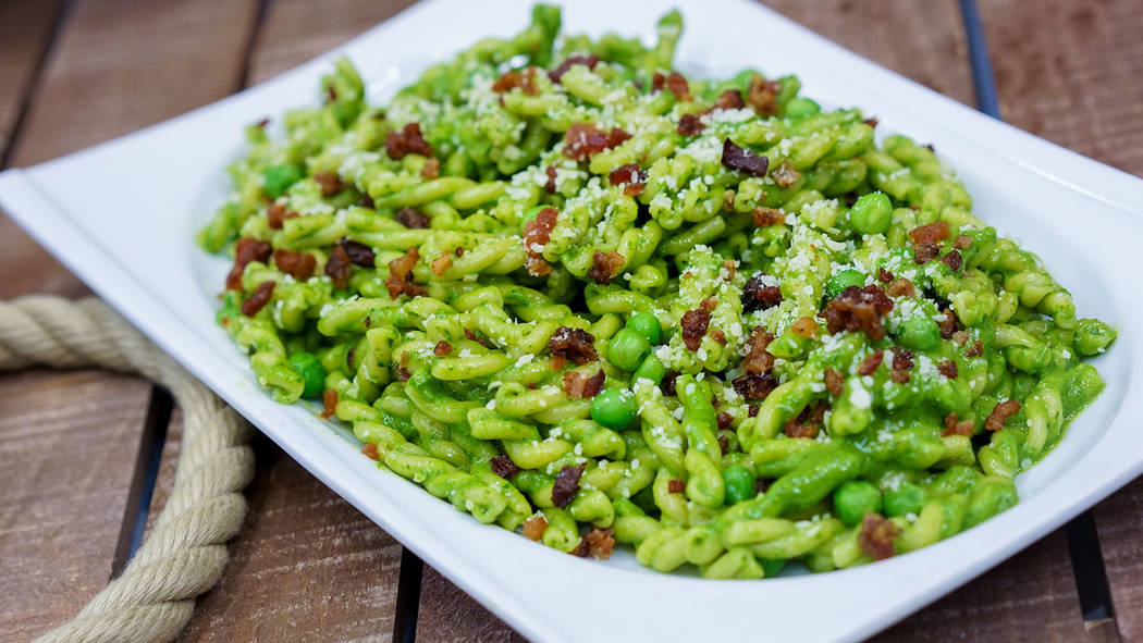 Favorite Pixar pals and stories are inspiring delicious eats, such as this green pesto pasta in Tomorrowland at Disneyland park. (Disneyland Resort)
