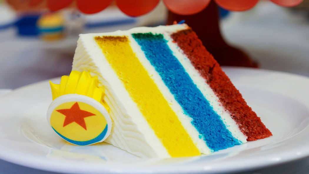 Favorite Pixar pals and stories are inspiring delicious treats, such as this Pixar Fest Celebration Cake, inspired by the familiar yellow Pixar Ball, at Plaza Inn at Disneyland park and Boardwalk  ...