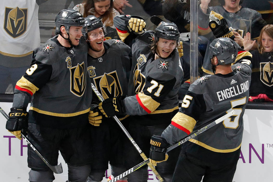 In this March 31, 2018, file photo, Vegas Golden Knights players celebrate after center William Karlsson (71) scored against the San Jose Sharks during the third period of an NHL hockey game in La ...