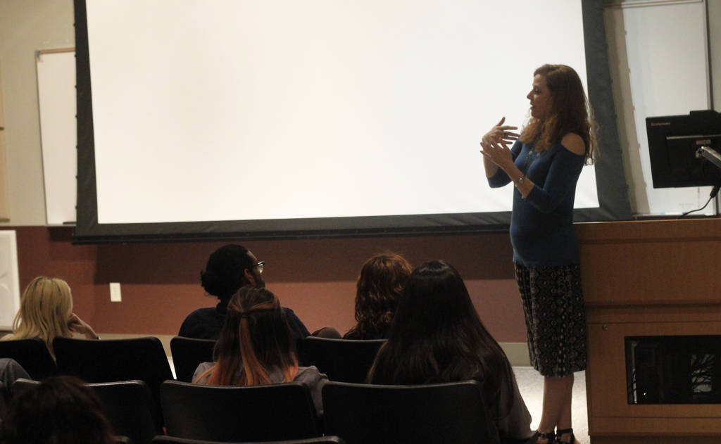 "Daniele Dreitzer, executive director of The Rape Crisis Center, speaks with an audience in preparation for the ""I Am Evidence"" screening shown on Monday, April 9, 2018 at the College of Southern N ..."