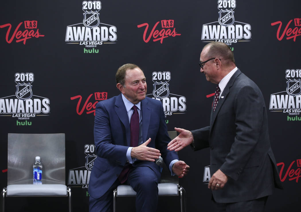 NHL commissioner Gary Bettman, left, shakes hands with Rossi Ralenkotter, president and CEO of the Las Vegas Convention and Visitors Authority, after the announcement of the return of the NHL Awar ...