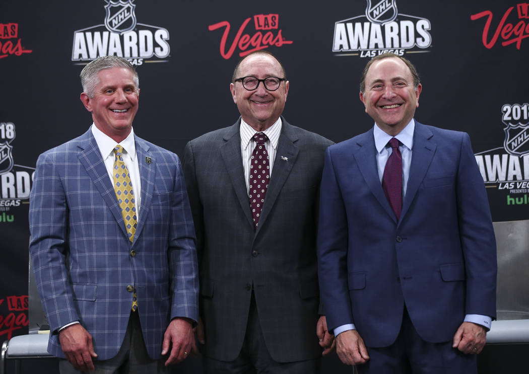 NHL commissioner Gary Bettman, center, poses with Golden Knights president Kerry Bubolz, left, and Rossi Ralenkotter, president and CEO of the Las Vegas Convention and Visitors Authority, after th ...