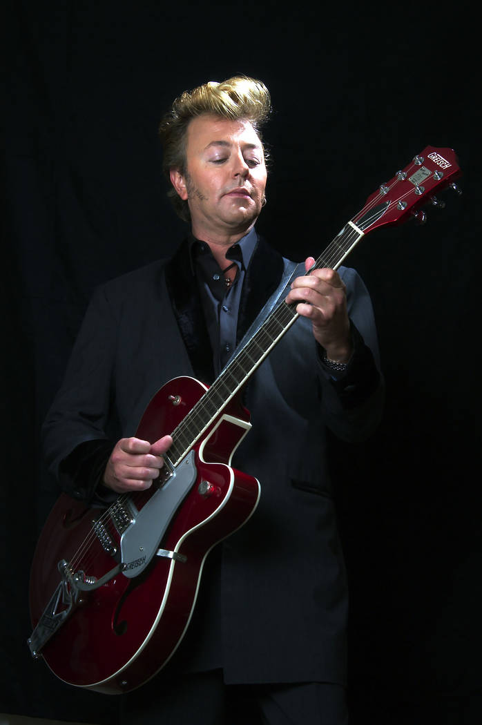 "**FILE **Brian Setzer poses with his guitar in New York, in this Sept. 18, 2003, file photo. On ""Wolfgang's Big Night Out,"" out in late September 2007, the Brian Setzer Orchestra gives a ..."