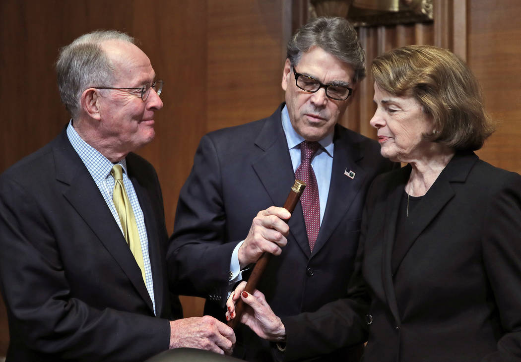 Chairman Lamar Alexander, R-Tenn., left, Energy Secretary Rick Perry, and Sen. Dianne Feinstein, D-Calif., look at a cane that once belonged to Sam Houston that is now owned by Alexander, before P ...