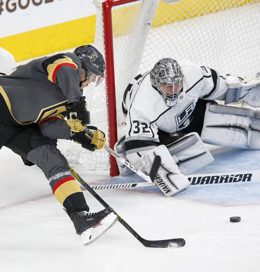 Golden Knights left wing Tomas Nosek (92) comes from behind the net for an attempt on Los Angeles Kings goaltender Jonathan Quick (32) as Kings center Jeff Carter (77) defends during the third per ...