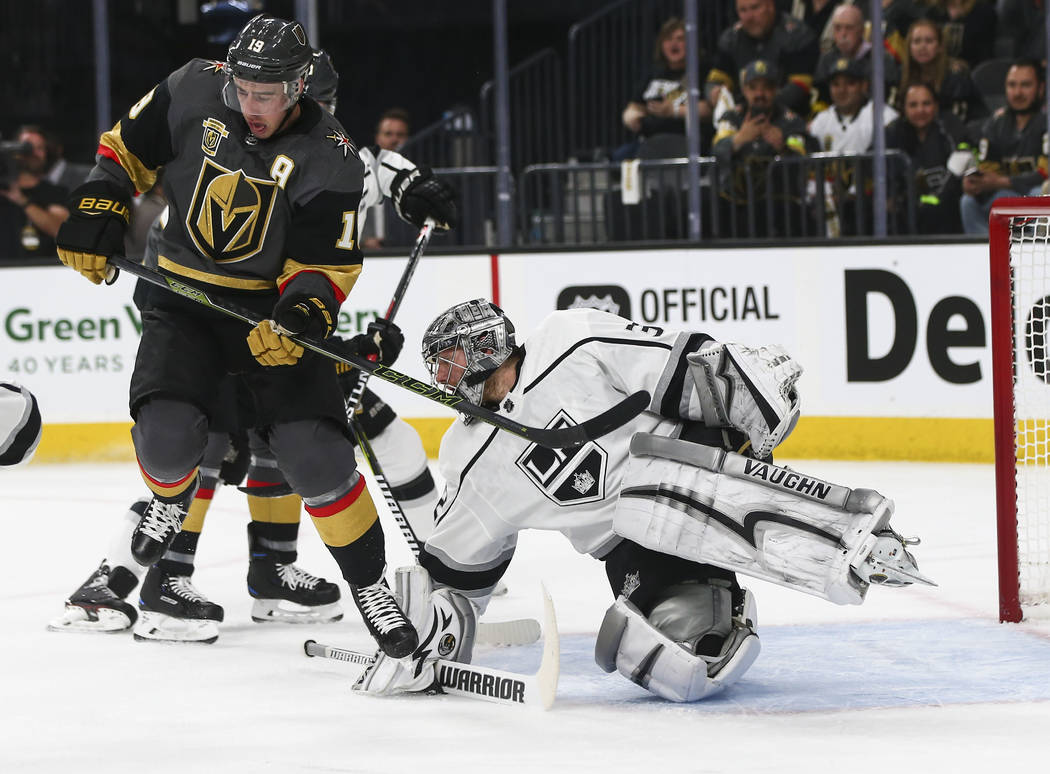 Los Angeles Kings goaltender Jonathan Quick (32) defends as Golden Knights right wing Reilly Smith (19) looks on during the first period of Game 1 of an NHL hockey first round playoff series at T- ...