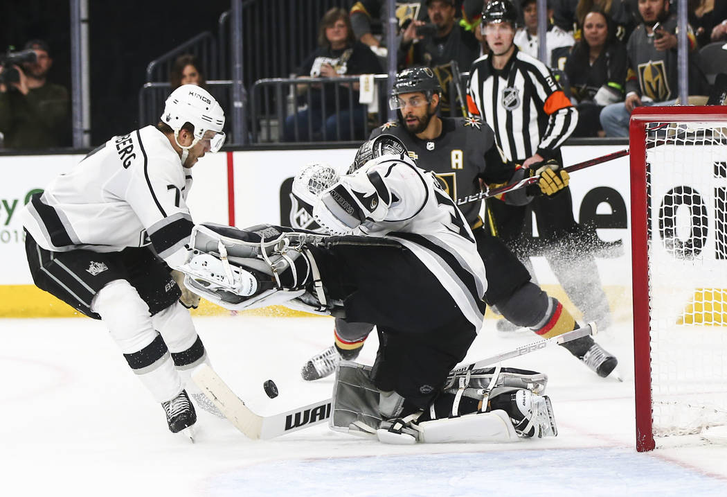 Los Angeles Kings goaltender Jonathan Quick (32) defends the goal as Golden Knights left wing Pierre-Edouard Bellemare looks on during the third period of Game 1 of an NHL hockey first-round playo ...