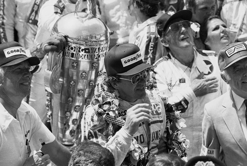 A smiling Tom Sneva waves to race fans from victory lane at the Indianapolis Motor Speedway on May 29, 1983 after winning the 67th annual race at an average speed of 162.117 mph in Indianapolis. H ...