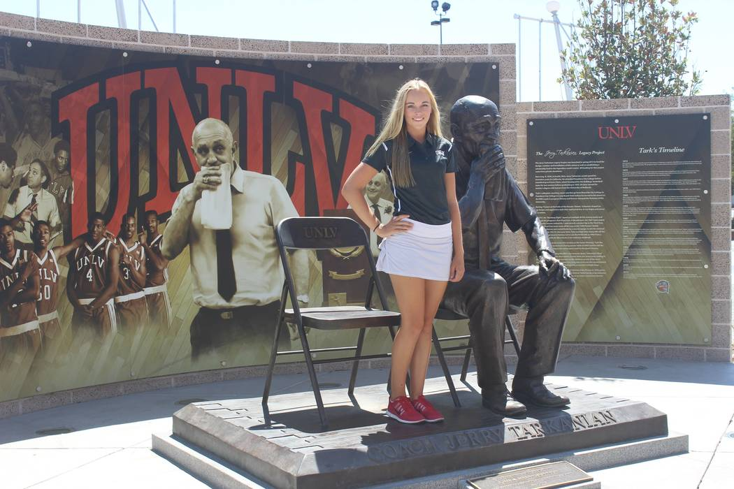 Veronica Joels poses with the Jerry Tarkanian statue at UNLV after orally committing to play golf for the UNLV women's team. (Courtesy of the Joels family)