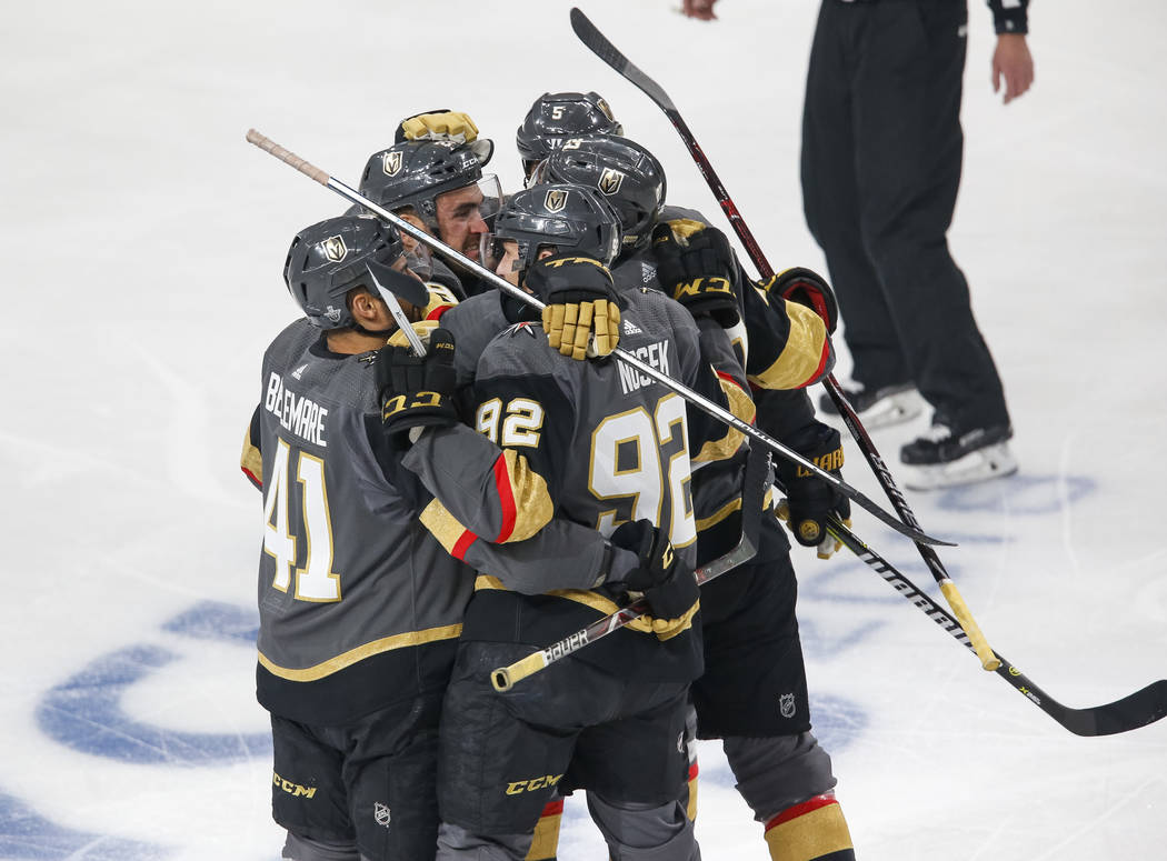 The Golden Knights celebrate a first period goal by defenseman Shea Theodore (27) during Game 1 of an NHL hockey first-round playoff series between the Golden Knights and the Los Angeles ...