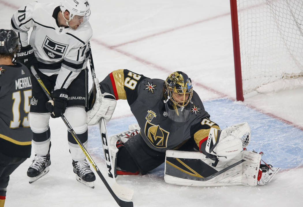 Golden Knights goaltender Marc-Andre Fleury (29) makes a save as Los Angeles Kings left wing Tanner Pearson (70) looks for a rebound during the first period of Game 1 of an NHL hockey first-round  ...