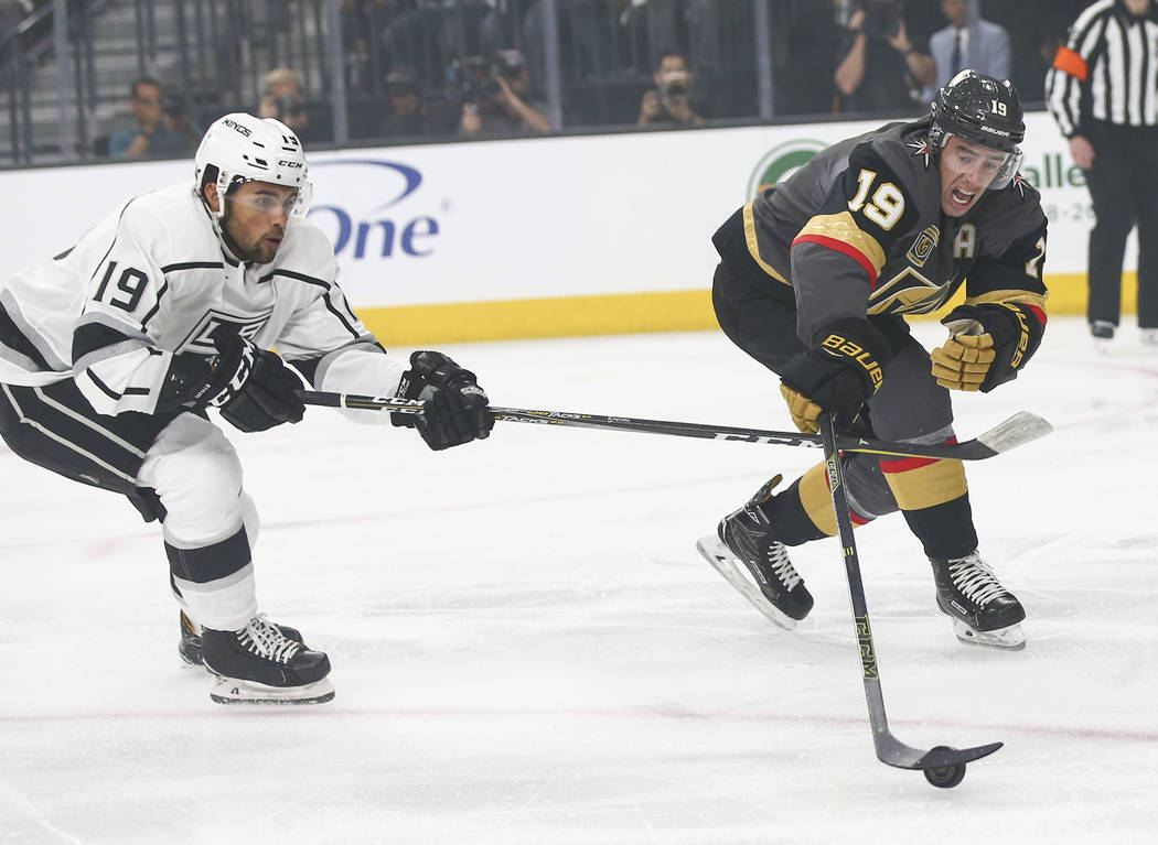 Golden Knights right wing Reilly Smith, right, controls the puck as Los Angeles Kings center Alex Iafallo defends  during the first period of Game 1 of an NHL hockey first round playoff series at  ...