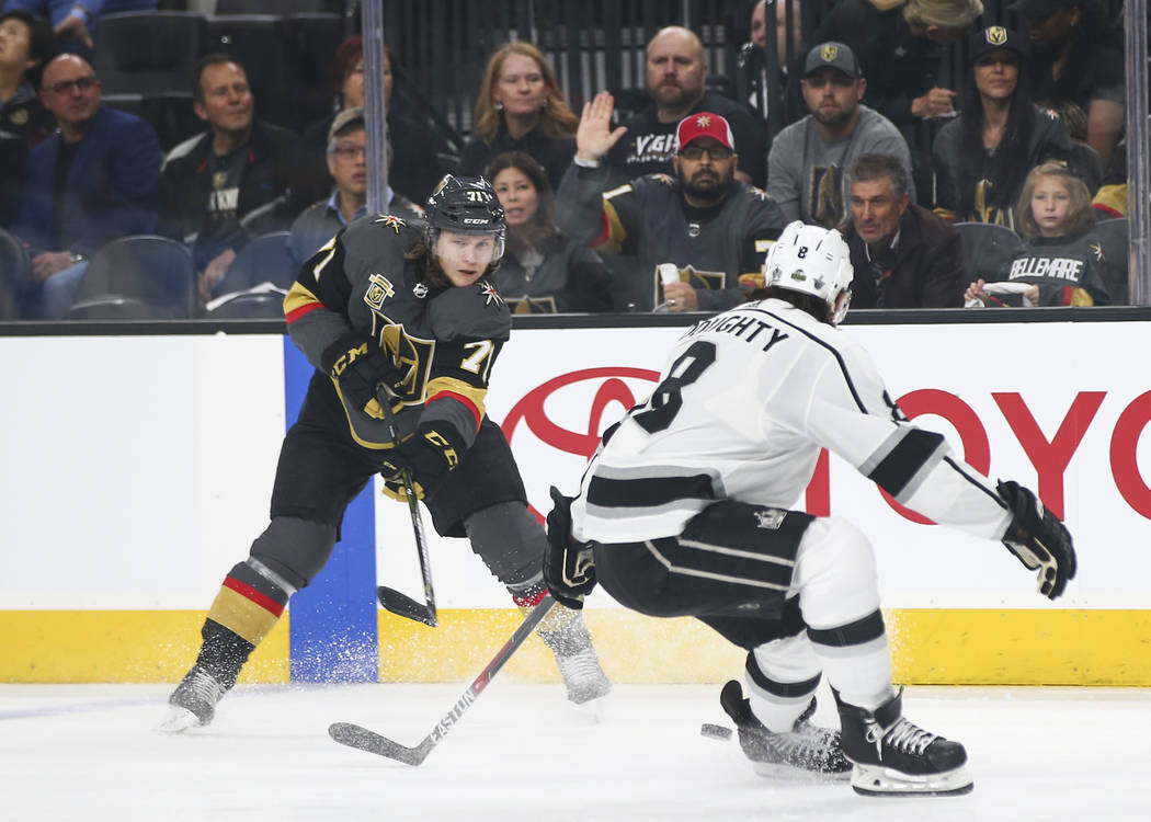 Golden Knights center William Karlsson (71) sends the puck past Los Angeles Kings defenseman Drew Doughty (8) during the first period of Game 1 of an NHL hockey first round playoff series at T-Mob ...