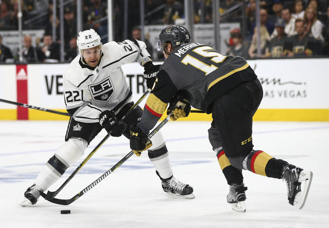 Los Angeles Kings center Trevor Lewis (22) looks to shoot past Golden Knights defenseman Jon Merrill (15) during the second period of Game 1 of an NHL hockey first-round playoff series at T-Mobile ...
