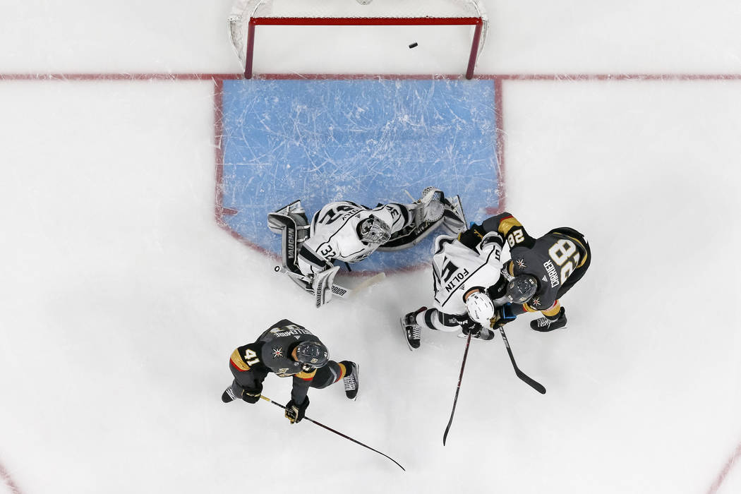 A goal shot by Vegas Golden Knights defenseman Shea Theodore (27) gets past Los Angeles Kings goaltender Jonathan Quick (32) during the first period of Game 1 of an NHL hockey first-round playoff  ...