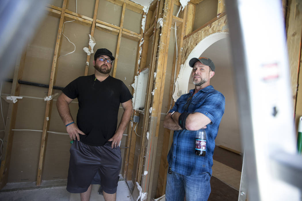 Louie DeSangro, left, owner of West Coast Build and Design, and David Shick, veteran and sponsors relations officer for Guns to Hammers, at the home of Ed Wiesing in Las Vegas, Thursday, April 12, ...