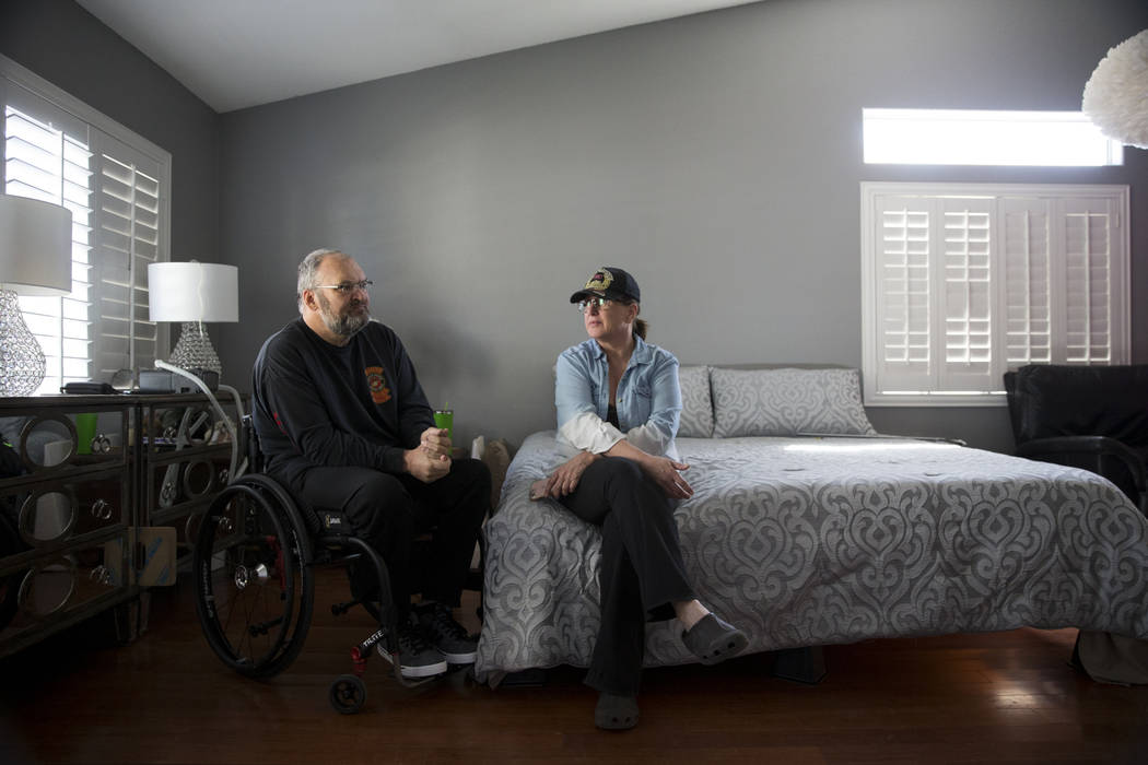 Military veteran Ed Wiesing with his wife Dana Wagner, at their Las Vegas home, Thursday, April 12, 2018. Wiesing underwent a surgical procedure last year that left him paralyzed from his legs. Th ...