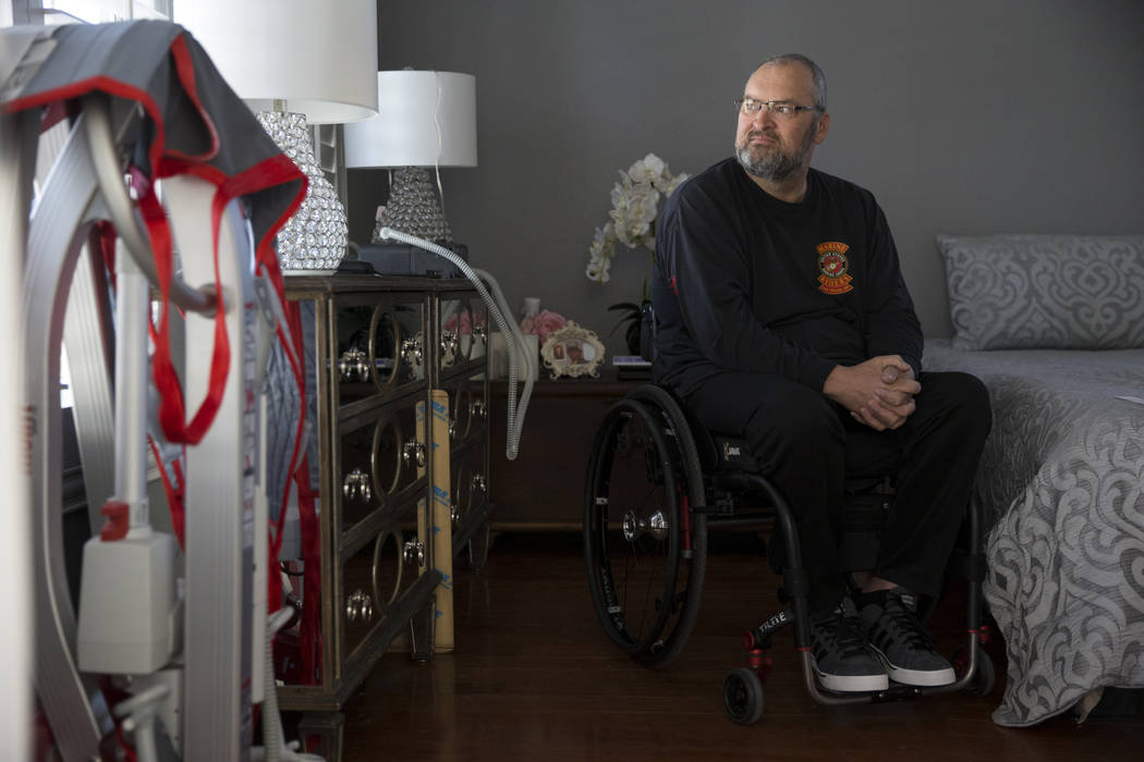 Military veteran Ed Wiesing at his Las Vegas home, Thursday, April 12, 2018. Wiesing underwent a surgical procedure last year that left him paralyzed from his legs. The veteran support group Guns ...
