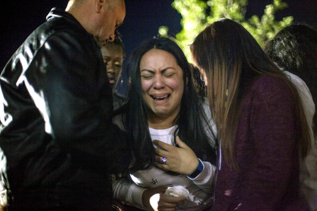 Elena Pineda, the mother of Helena Lagos, collapses during a vigil for her daughter Helena Lagos in Las Vegas, Friday, April 13, 2018. Lagos and five others were killed Monday night in a fiery cra ...