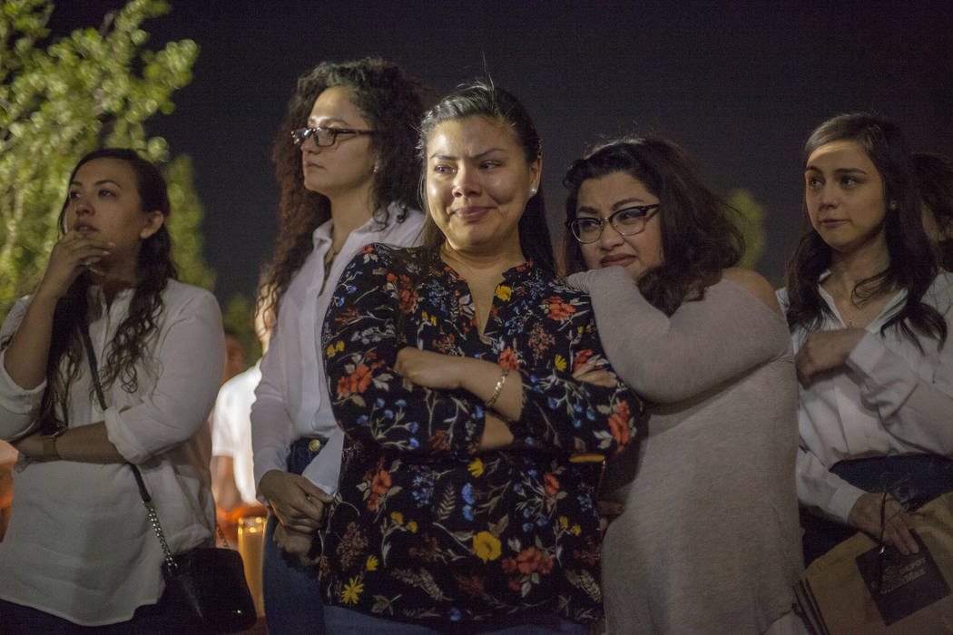 Priscilla Gudino, from left, Tanya Del Real, Daniela Sanchez, Desiree Tolentino, and Alexis Morales listen to friends and family reminisce about Helena Lagos during a vigil in her honor in Las Veg ...