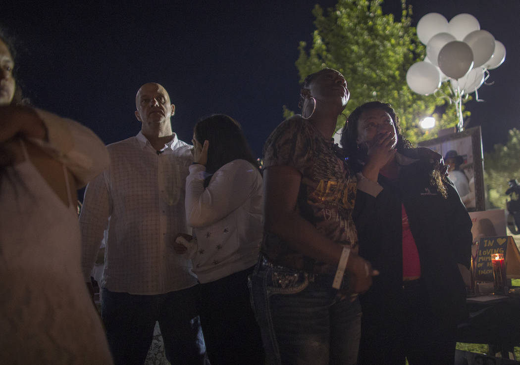 The parents of Helena Lagos Kash Christoper, from left, his wife Elena Pineda, and family friends Cami Flowers and Alexandra Lee watch as balloons float away at a vigil to honor Lagos in Las Vegas ...