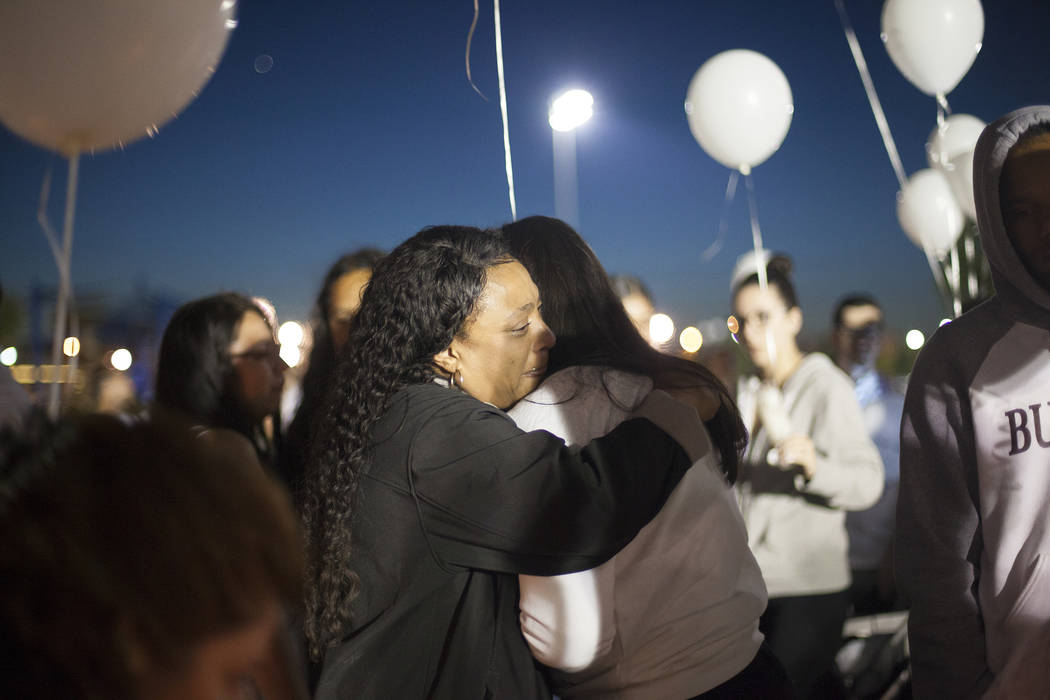 Alexandra Lee hugs Elena Pineda at a vigil for Pineda's daughter Helena Lagos in Las Vegas, Friday, April 13, 2018. Lagos and five others were killed Monday night in a fiery crash of a small plane ...