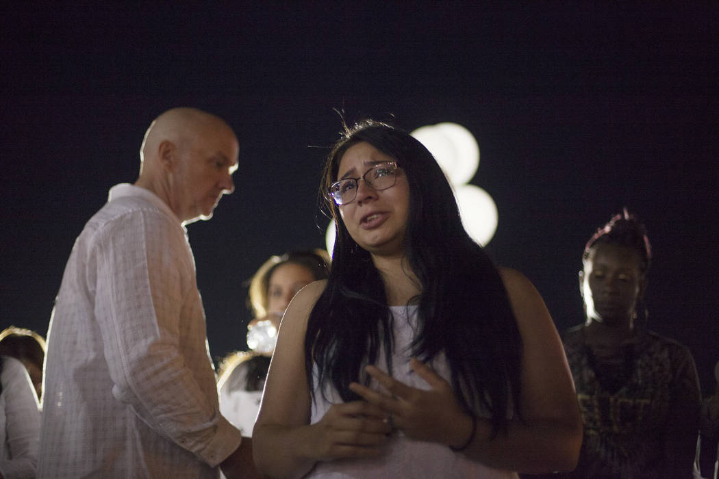 Jennifer Hurtado talks about Helena Lagos, who she was really close with, at a vigil for Lagos in Las Vegas, Friday, April 13, 2018. Lagos and five others were killed Monday night in a fiery crash ...