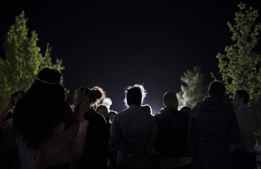 Family and friends gather at a vigil to honor Helena Lagos in Las Vegas, Friday, April 13, 2018. Lagos and five others were killed Monday night in a fiery crash of a small plane on a golf course i ...
