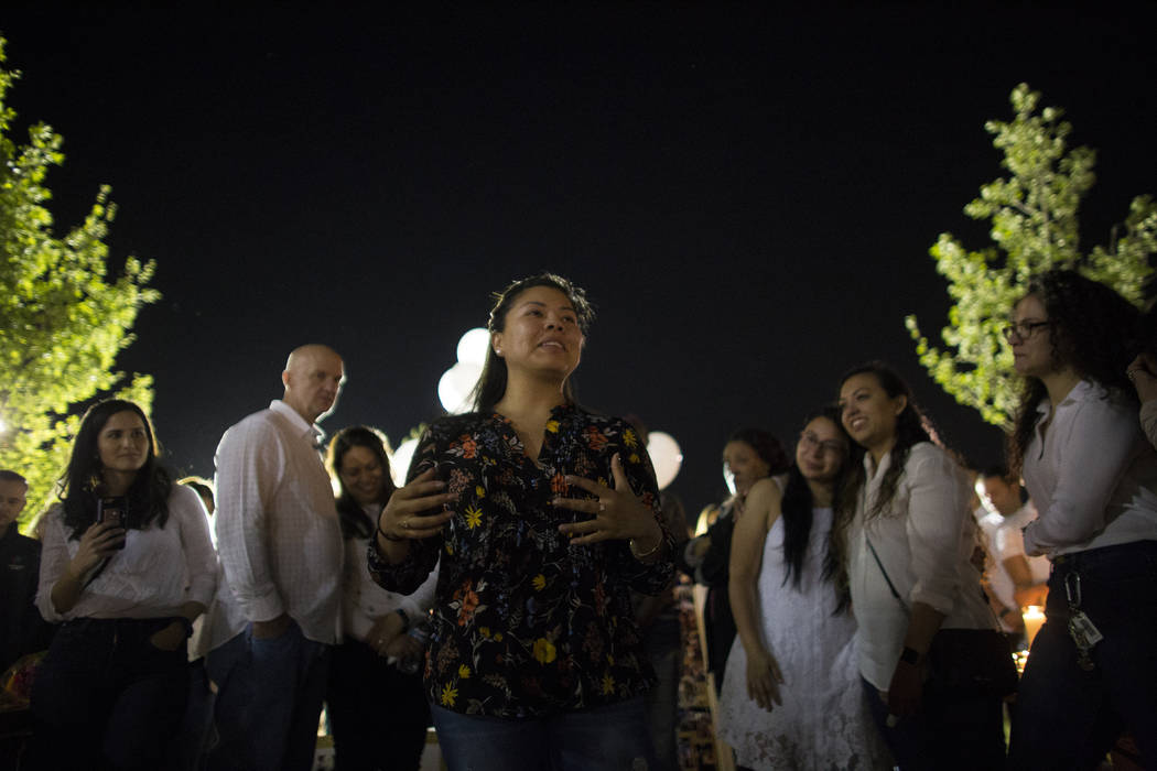 Daniela Sanchez reminisces about Helena Lagos in front of family and friends during her vigil in Las Vegas, Friday, April 13, 2018. Lagos and five others were killed Monday night in a fiery crash ...