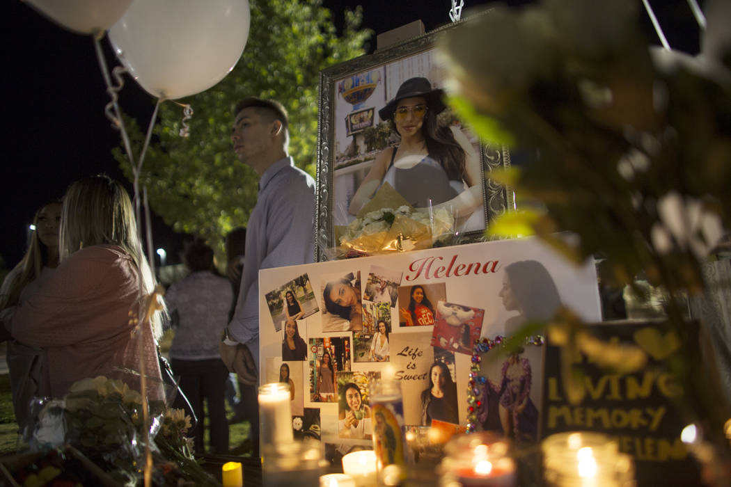 Photos and candles at a vigil for UNLV student Helena Lagos in Las Vegas, Friday, April 13, 2018. Lagos and five others were killed Monday night in a fiery crash of a small plane on a golf course ...