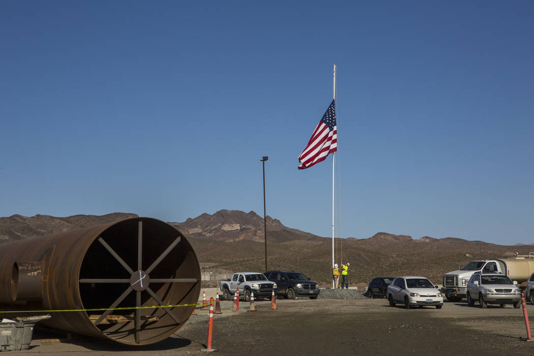 Construction workers raise the American flag at the Southern Nevada Water Authority's low-lake-level pumping station, currently under construction at Lake Mead, on Saturday, April 14, 2018. Patr ...