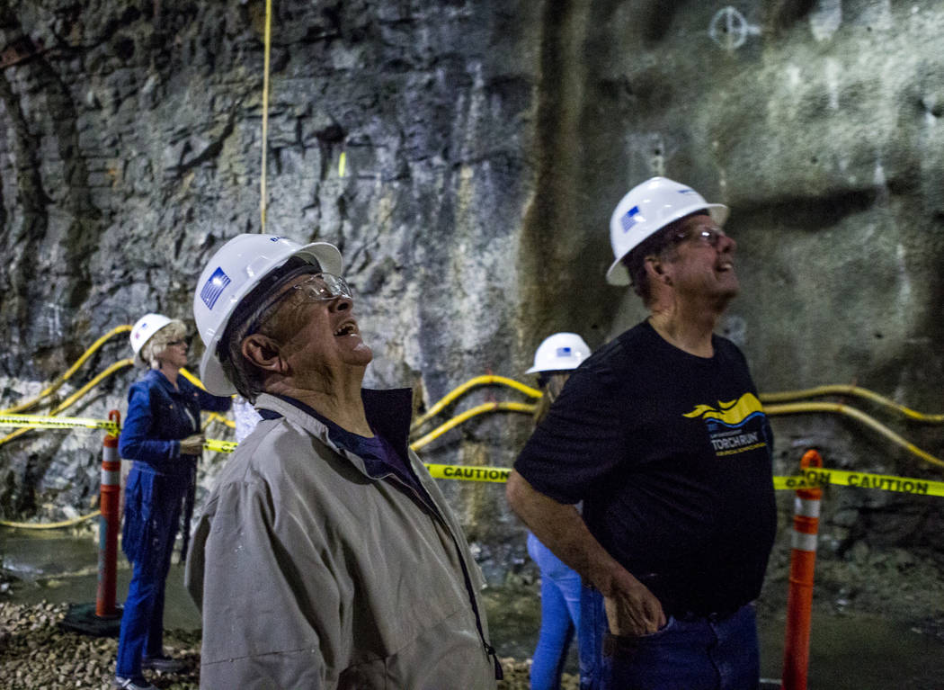 Las Vegas City Councilman Bob Coffin, center left, and North Las Vegas Mayor John Lee glance up while checking out an underground connector tunnel, part of the Southern Nevada Water Authority's lo ...