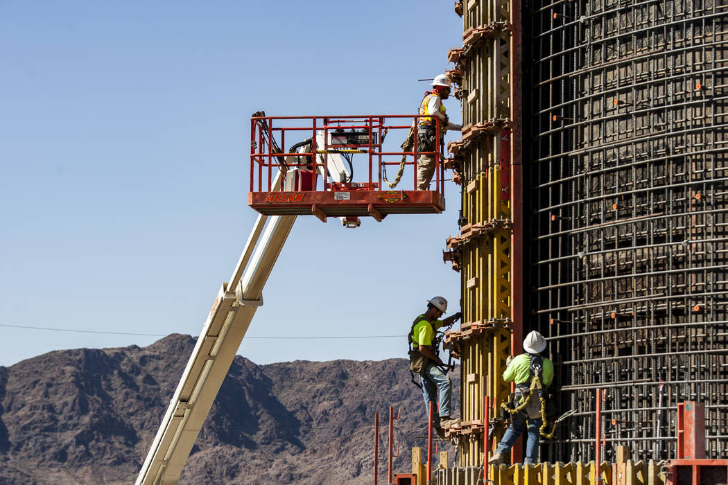 Construction workers build pieces of the surge tank at Southern Nevada Water Authority's low-lake-level pumping station, currently under construction at Lake Mead, on Saturday, April 14, 2018. P ...