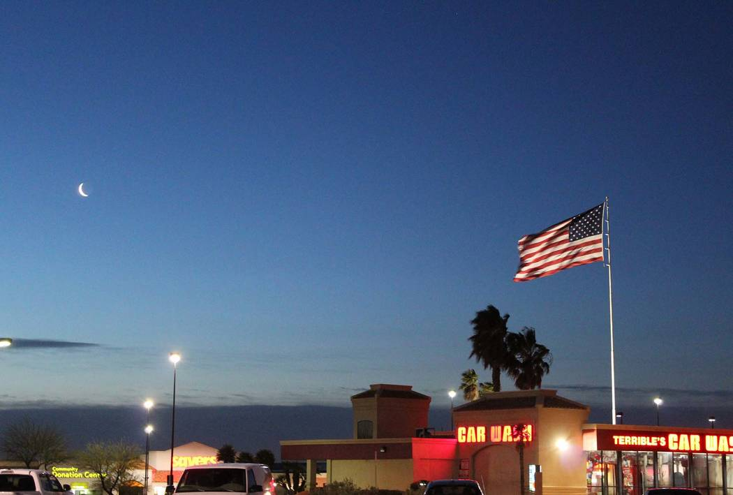 Winds whip the flag at Terrible Herbst Car Wash at Rampart and Lake Mead boulevards, Thursday, April 12, 2018. (Max Michor/Las Vegas Review-Journal)