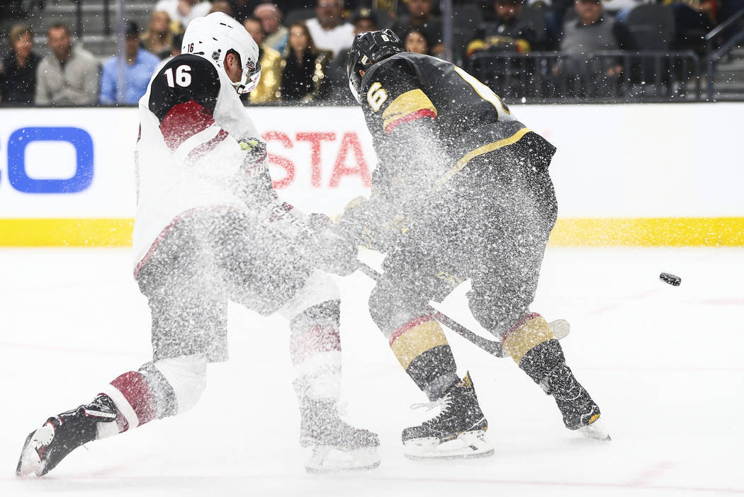 Arizona Coyotes left wing Max Domi (16) shoots past Golden Knights defenseman Colin Miller (6) during the second period of an NHL hockey game at T-Mobile Arena in Las Vegas on Wednesday, March 28, ...