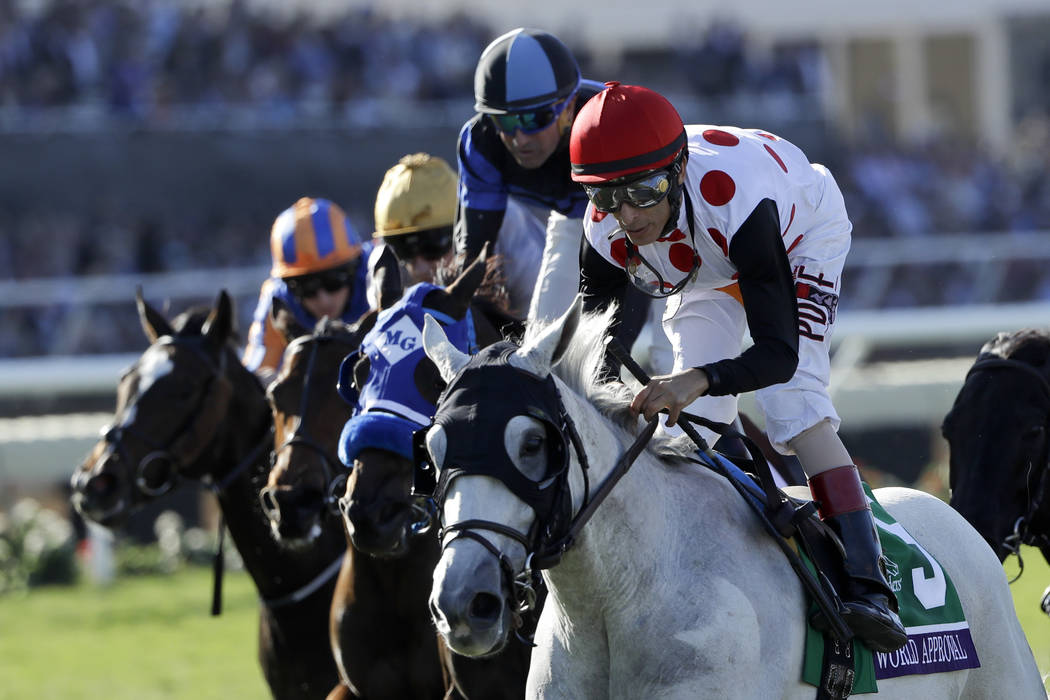 John Velazquez, right, rides World Approval to victory in the Mile horse race during the Breeders' Cup, Saturday, Nov. 4, 2017, in Del Mar, Calif.(AP Photo/Gregory Bull)