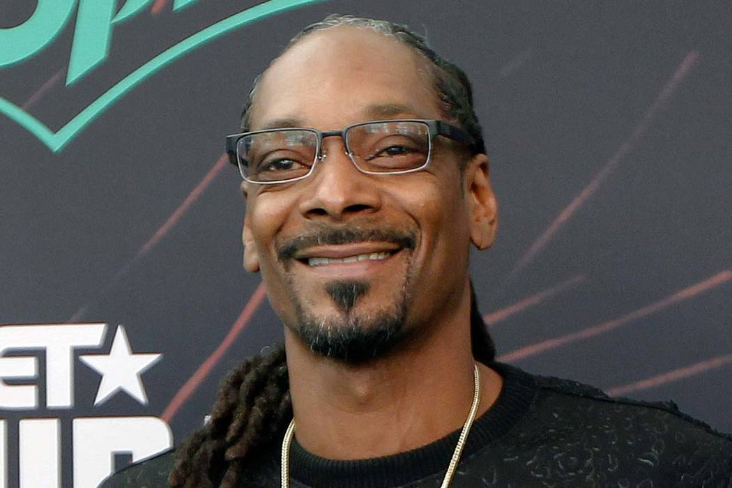 In this Sept. 17, 2016, file photo, Snoop Dog smiles at the BET Hip Hop Awards in Atlanta. The rapper and hockey fan is appearing in a series of Hockey 101 videos in which he gives shoutouts to th ...