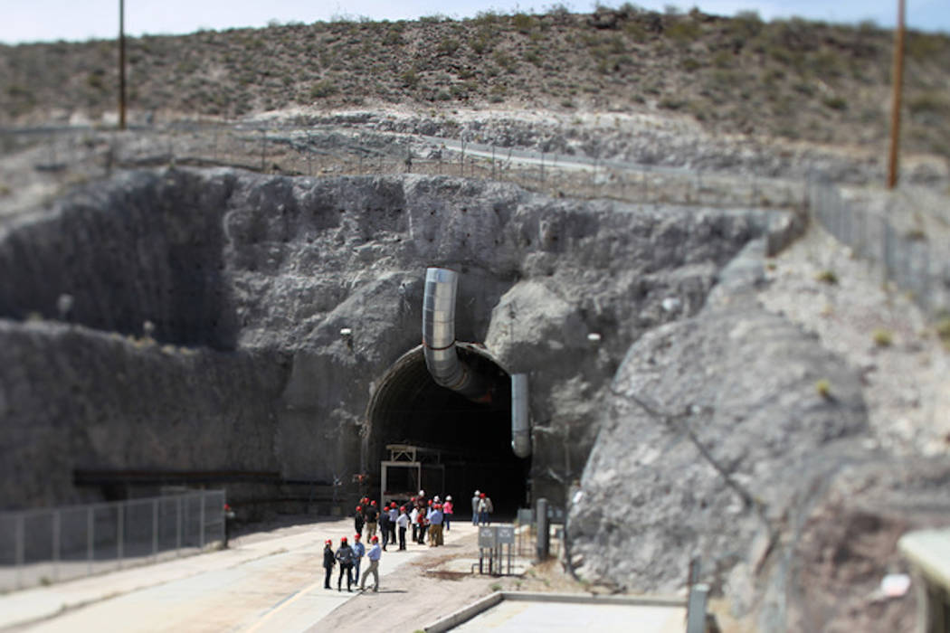 Congressional staff members, media and Department of Energy employees wait for congressmen to emerge from the north portal during a congressional tour of the Yucca Mountain exploratory tunnel Thur ...