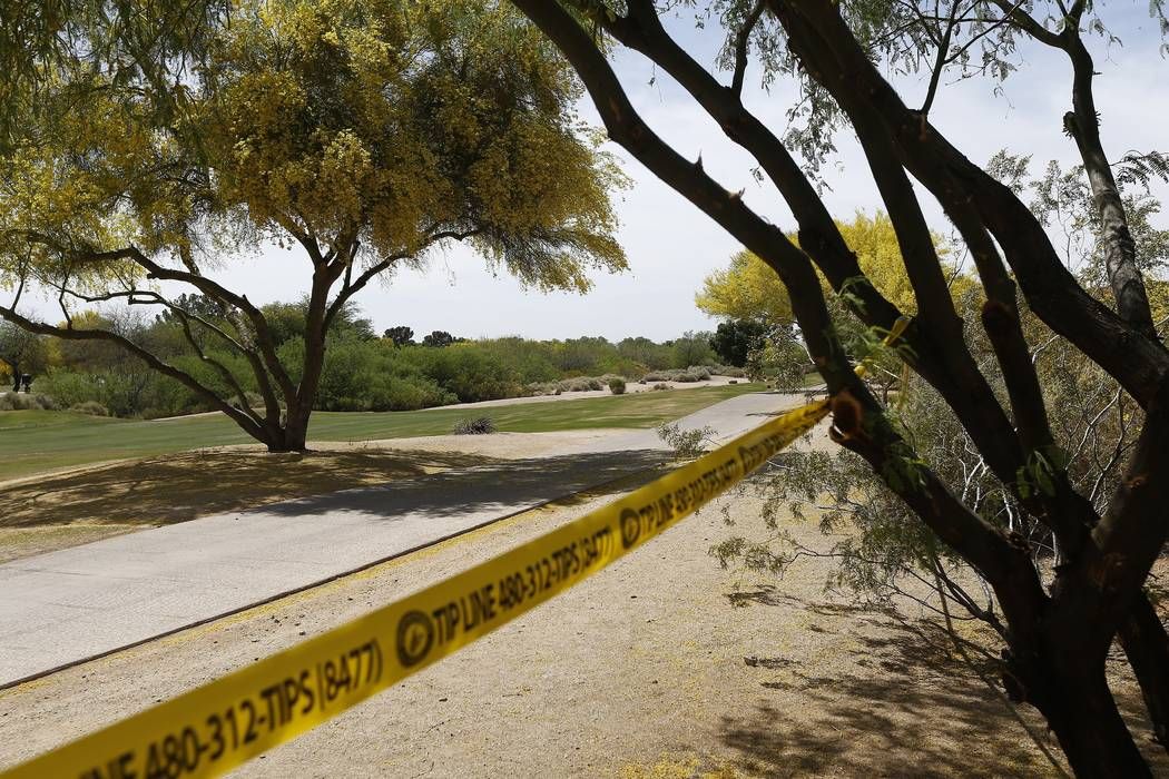 Police tape cordon off an area near the site of a plane crash that killed several people Tuesday, April 10, 2018, in Scottsdale, Ariz. (AP Photo/Ross D. Franklin)